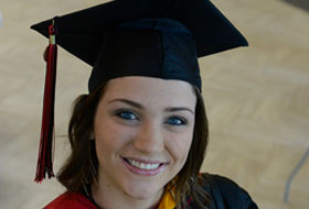 Female graduate smiling