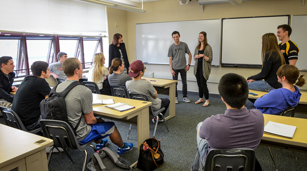 Students giving presentation in La Roche classroom