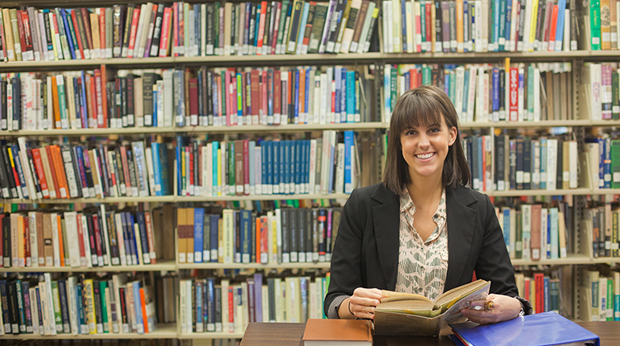 Student in John J. Wright Library