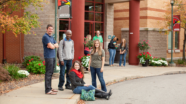 Group of La Roche College students hanging out in front of Kerr Fitness & Sports Center