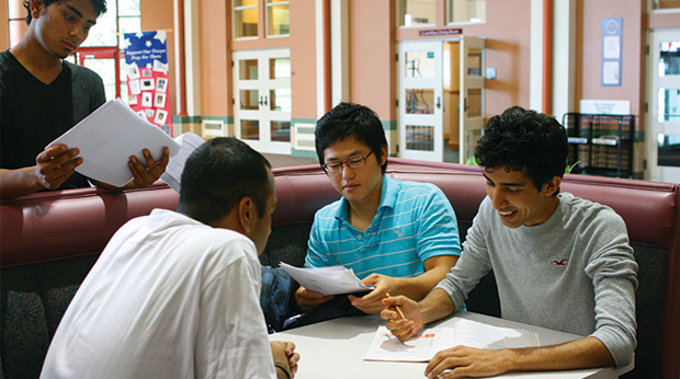 International Students sitting at booth in College Square