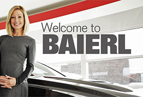 Woman standing in a Baierl Dealership