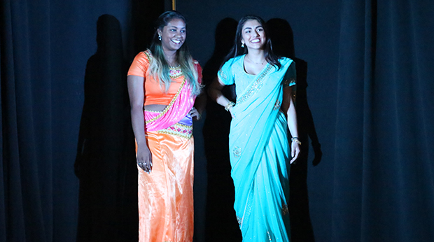 Two female students modeling clothing at the annual GLOBE Fashion Show in the Kerr Fitness & Sports Center